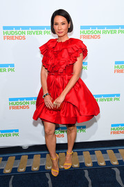 Lucy Liu went the frilly route in a red ruffle cocktail dress by Greta Constantine at the Hudson River Park Gala.