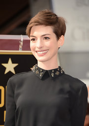 Anne swept her short tresses to the side to create this super-cute pixie style.