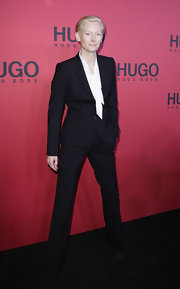 Tilda looks oh so sweet in a tailored suit with a tie-neck blouse.