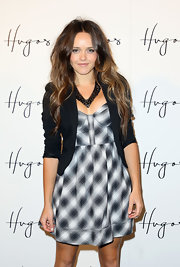 Rebecca dons a little plaid corset dress with a tiny blazer and a beautiful statement necklace.