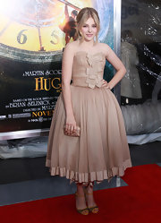 Chloe Moretz paired her lovely full-skirted frock with peep-toe heels complete with bold orange piped detailing.
