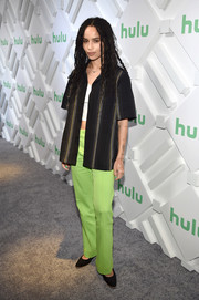 Zoe Kravitz teamed her top with a pair of lime-green pants.