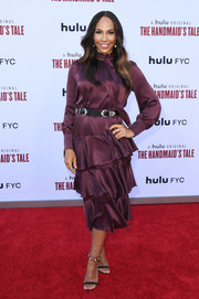 Amanda Brugel kept it demure in a long-sleeve purple silk dress with a tiered skirt at the 'Handmaid's Tale' season 3 finale celebration.