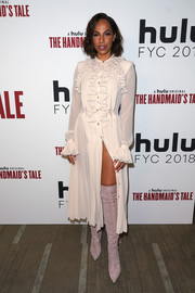 Amanda Brugel contrasted her ladylike dress with edgy lilac over-the-knee boots.
