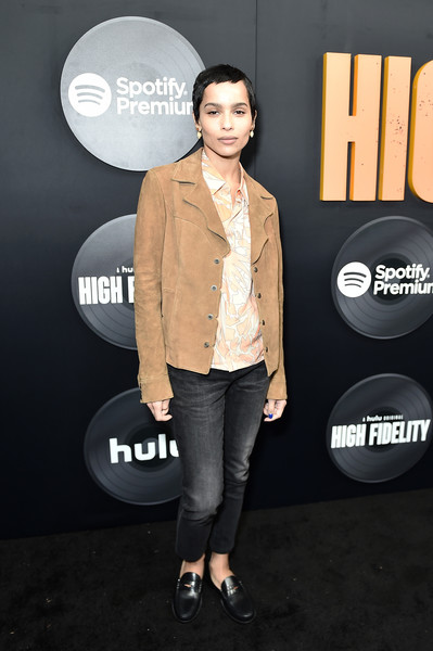 For her footwear, Zoe Kravitz chose classic black penny loafers.