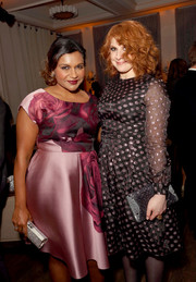 Mindy Kaling paired a silver tube clutch with a lilac floral dress for the Hulu Holiday Party.