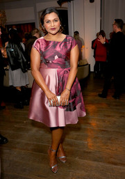 Mindy Kaling went for ladylike charm in a pink rose-print dress at the Hulu holiday party.