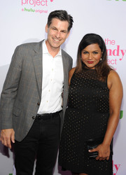 Mindy Kaling matched a black hard-case clutch with a studded LBD for the 'Mindy Project' season 4 premiere.