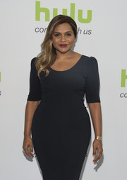 Mindy Kaling was minimalist-chic at the Hulu TCA Summer Press Tour wearing this gold bangle and LBD combo.
