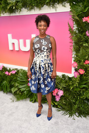 Samira Wiley complemented her dress with blue ankle-strap pumps by Jimmy Choo.