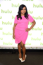 Mindy Kaling donned a Barbie-pink neoprene top by Finders Keepers for the 2014 Hulu Upfront.