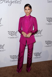 Zendaya Coleman was monochromatic-chic in a fuchsia pantsuit by Christian Siriano at the Humane Society of the United States' To The Rescue Gala.