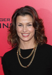 Bridget Moynahan attended the 'Catching Fire' NYC premiere wearing her hair in bouncy curls.