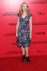 Patricia Clarkson looked very girly in a colorful print dress with a flirty hem during the 'Catching Fire' NYC premiere.