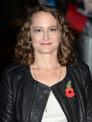 Nina Jacobson styled her hair with bouncy curls for the 'Catching Fire' London premiere.