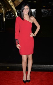 Linzi Stoppard was sexy yet tasteful in a red one-shoulder dress during the 'Catching Fire' London premiere.