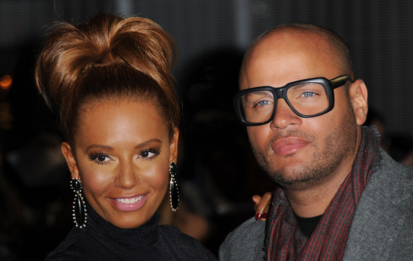 Melanie Brown applied a super-shiny satiny-smooth gloss for 'The Hunger Games' European premiere.