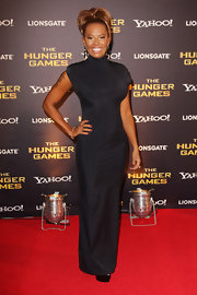 Melanie Brown wore this figure-hugging black dress to the 'Hunger Games' premiere.