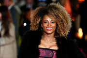Fleur East rocked voluminous curls at the 'Hunger Games: Mockingjay Part 1' premiere.