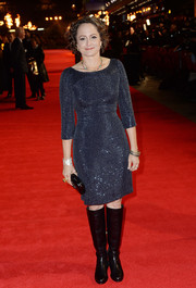 Nina Jacobson toughened up her dress with a pair of black riding boots.