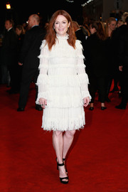 Julianne Moore sashayed down the red carpet wearing a tiered white Alexander McQueen cocktail dress at the UK premiere of 'The Hunger Games: Mockingjay Part 2.'