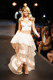Sylvie van der Vaart's flirty look for the catwalk was completed with delicate gold strappy sandals.