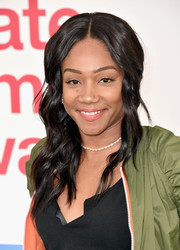 Tiffany Haddish attended the Hunter for Target Ultimate Family Festival wearing this wavy, center-parted hairstyle.