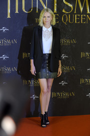 Charlize Theron injected some edge with a black leather mini skirt by Reformation.