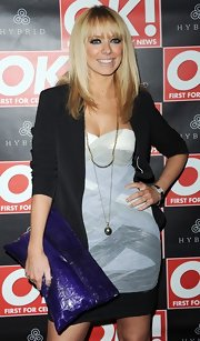 Liz Mcclarnon wore a sophisticated sweetheart-neckline cocktail dress with a criss-cross pattern to the Hybrid and OK Magazine party.
