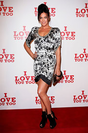 Megan Gale finished off her look in edgy style with a pair of black peep-toe booties.