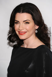 Julianna Margulies vamped up her black dress with a swipe of tomato red lipstick.