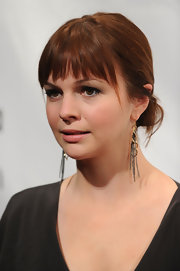 Amber Tamblyn paired her loose bun with chain embellished earrings.