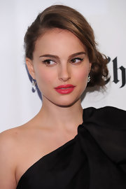 Natalie Portman added an elegant touch to her look with a sophisticated side bun.