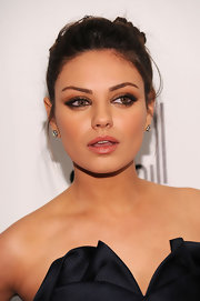 Mila Kunis paired her elegant updo with old-mine diamond cluster earrings.