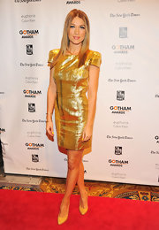 Natalie Zea stood out at the Gotham Independent Film Awards in this crisp gold cocktail dress.