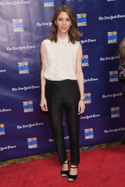 Sofia Coppola paired her top with black silk trousers.