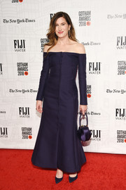Kathryn Hahn matched her dress with a navy satin purse, also by Gabriela Hearst.