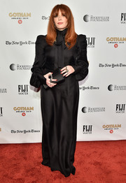 Natasha Lyonne matched her dress with a black satin clutch.