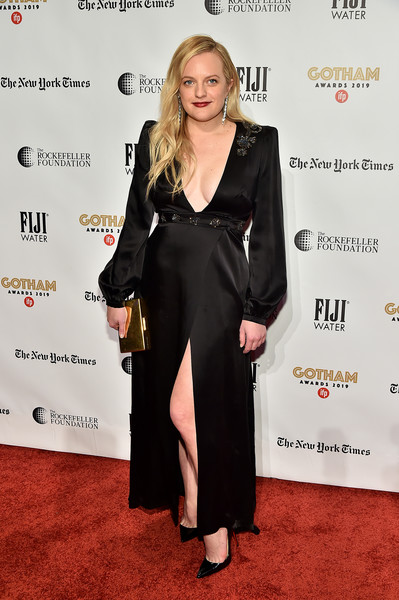 Elisabeth Moss punctuated her black look with a gold box clutch.
