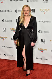 Elisabeth Moss went vampy in a black Dundas gown with a plunging neckline and a thigh-high slit at the 2019 Gotham Independent Film Awards.