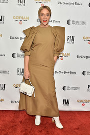 Chloe Sevigny styled her look with a white leather purse, also by Givenchy.