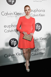 Jessica Chastain accessorized her look with a gold box clutch by Calvin Klein.