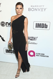 Lisa Rinna opted for a simple and classic one-shoulder gown by Balmain when she attended the Elton John AIDS Foundation Oscar-viewing party.