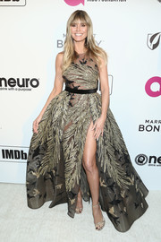Heidi Klum went for sexy glamour in a sheer, embellished ballgown by Elie Saab Couture at the Elton John AIDS Foundation Oscar-viewing party.