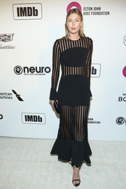 Maria Sharapova was edgy-sexy in a sheer-panel black dress by David Koma at the Elton John AIDS Foundation Oscar-viewing party.