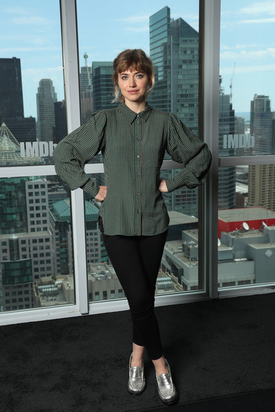 Imogen Poots added some shine with a pair of heeled silver loafers.