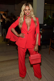 Laverne Cox brightened up NYFW with this red pantsuit by Prabal Gurung.