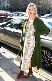 Underneath her coat, Princess Maria-Olympia wore a spring-chic floral dress.