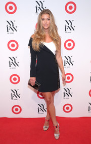 Nina Agdal worked a modern vibe in an asymmetrical black-and-white mini dress by Mugler at the IMG + Target official NYFW kickoff.