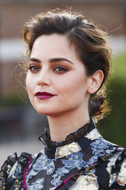 Jenna-Louise Coleman looked romantic wearing this messy-glam chignon at the premiere of 'Victoria.'